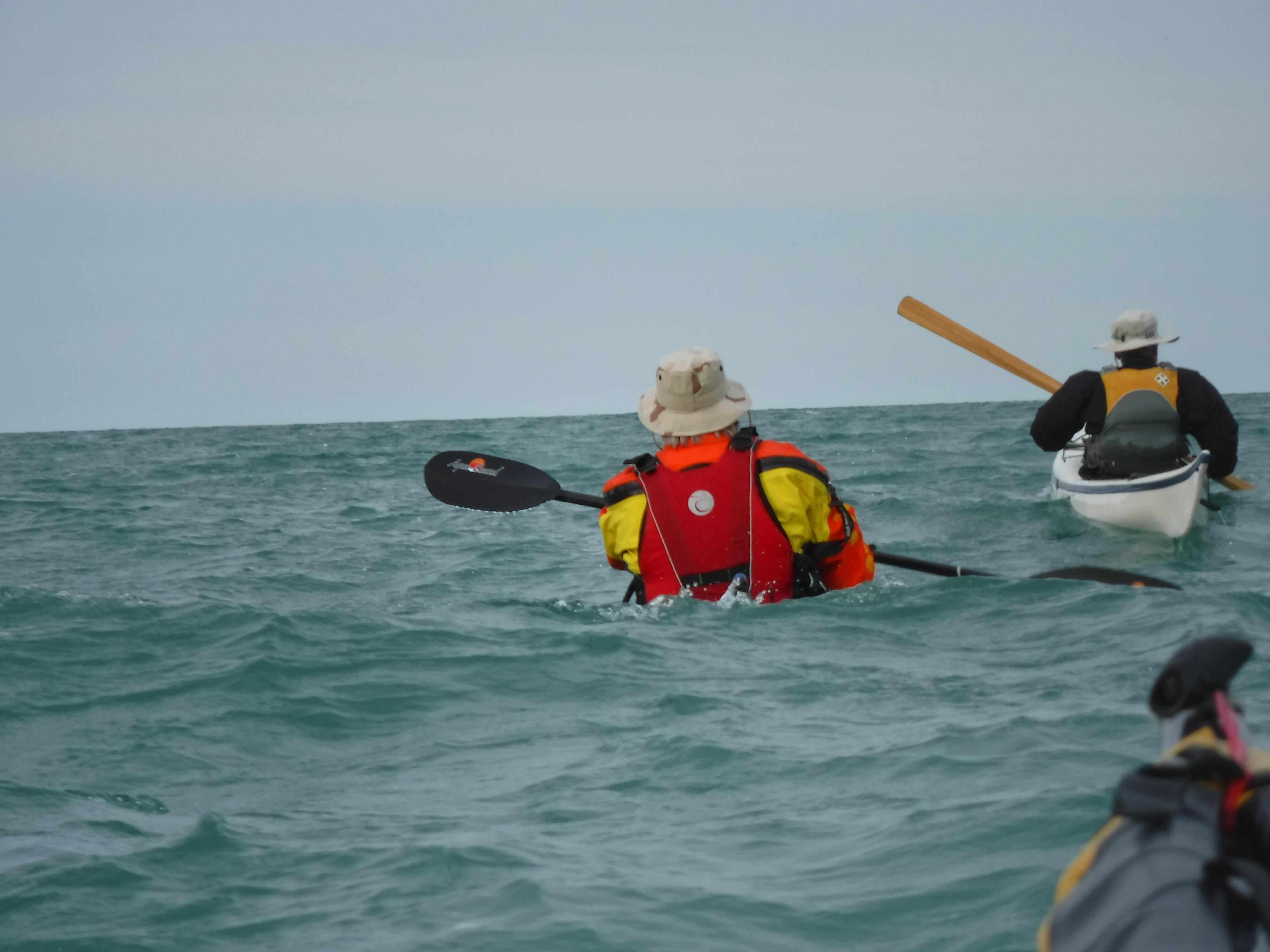 Playful wave action on Lake Michigan seakayaking