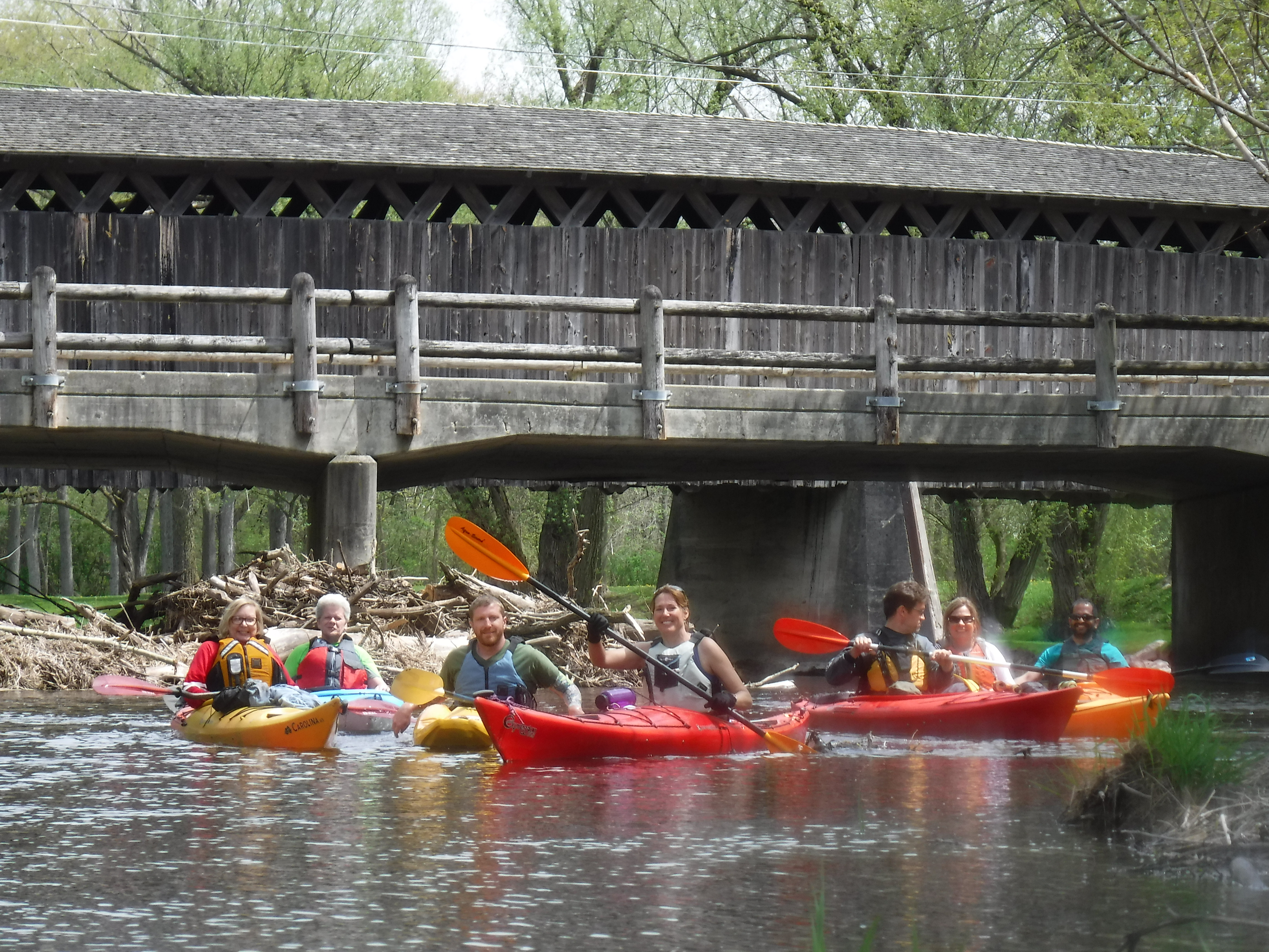 Group holds off a fun paddle trip long enough for a picture alongside the Covered Bridge, Wi