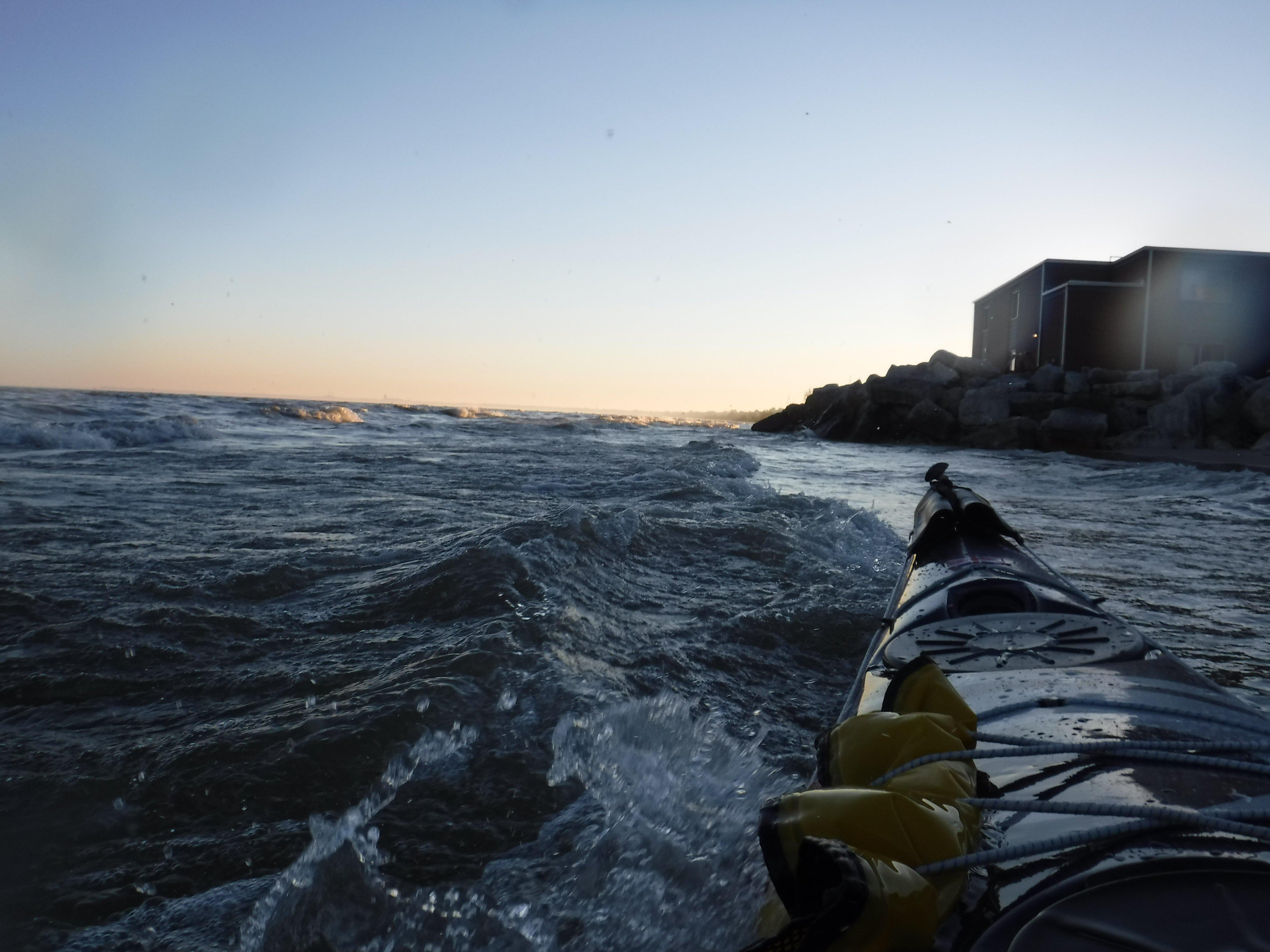 evening sea kayak paddle trip on Lake Michigan, two Rivers, Wi